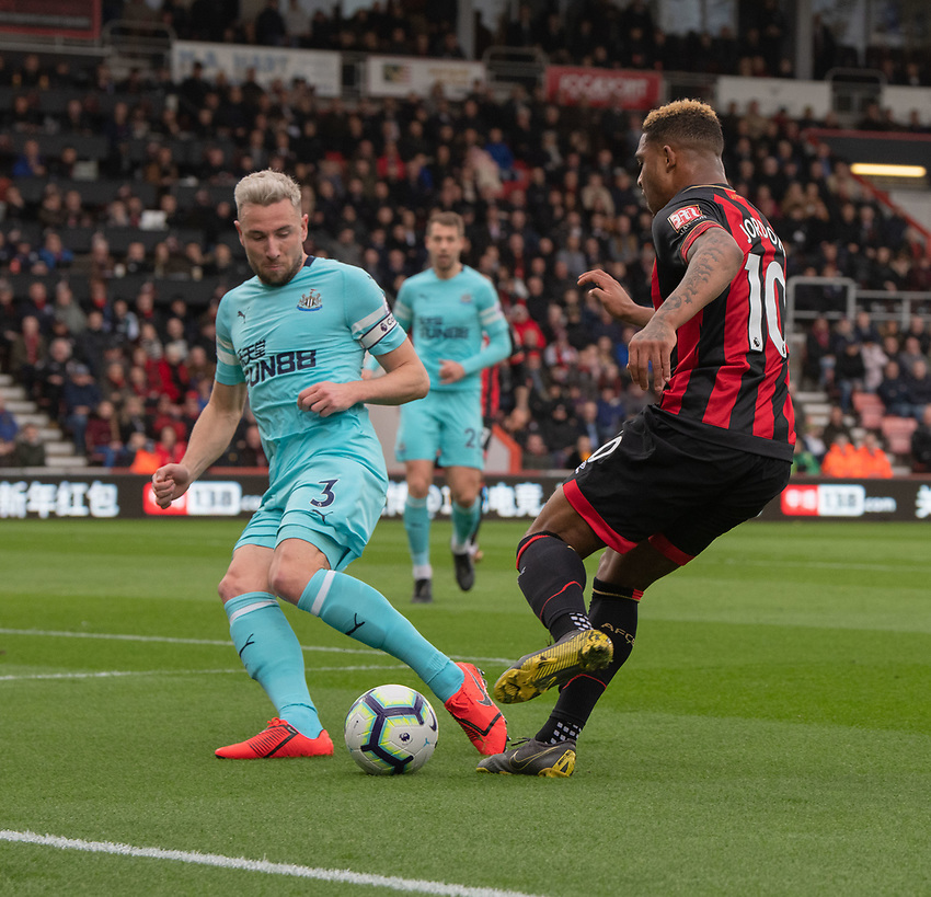 Bournemouth's Jordon Ibe (right) battles with Newcastle United's Paul Dummett (left) <br /> <br /> Photographer David Horton/CameraSport<br /> <br /> The Premier League - Bournemouth v Newcastle United - Saturday 16th March 2019 - Vitality Stadium - Bournemouth<br /> <br /> World Copyright © 2019 CameraSport. All rights reserved. 43 Linden Ave. Countesthorpe. Leicester. England. LE8 5PG - Tel: +44 (0) 116 277 4147 - admin@camerasport.com - www.camerasport.com