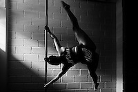 Valeria Aboultaif, a young Colombian pole dancer, spins around a pole during a training session in Academia Pin Up, a dance studio in Medellín, Colombia, 3 March 2016. Pole dance, a performance combining sport with art and merging dance with acrobatics on a vertical pole, has reached wide popularity in Latin America in the last decade. With dance and physical attraction being a natural way of expression for many Latinas, thousands of women take pole dancing classes in gyms and dance studios, as a form of fitness and social entertainment.
