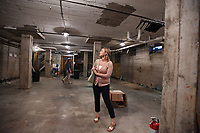 NWA Democrat-Gazette/J.T. WAMPLER  Kaitlyn Fondano, construction manager with Specialized Real Estate Group, looks around the basement Thursday August 8, 2019 at the former Farmers Cooperative building on Martin Luther King Jr. Blvd. <br />