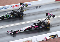 Oct 29, 2016; Las Vegas, NV, USA; NHRA top fuel driver Steve Torrence (near) races alongside Brittany Force during qualifying for the Toyota Nationals at The Strip at Las Vegas Motor Speedway. Mandatory Credit: Mark J. Rebilas-USA TODAY Sports