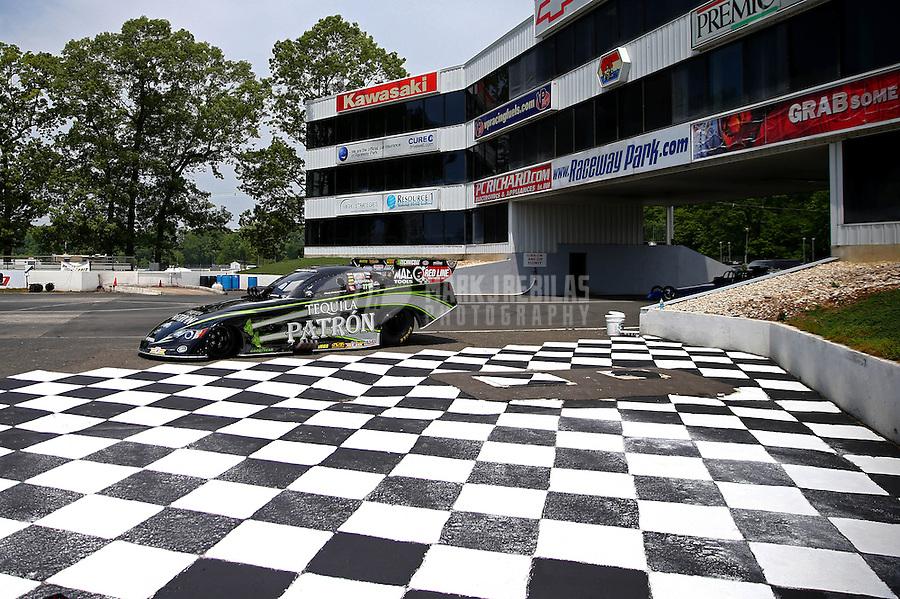 May 29, 2013; Englishtown, NJ, USA: The car of NHRA funny car driver Alexis DeJoria sits parked near the checkered flag winners circle at Raceway Park. Mandatory Credit: Mark J. Rebilas-