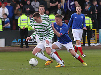 Conor McManus being pressured by Tom Walsh in the Celtic v Rangers City of Glasgow Cup Final match played at Firhill Stadium, Glasgow on 29.4.13,  organised by the Glasgow Football Association and sponsored by City Refrigeration Holdings Ltd..