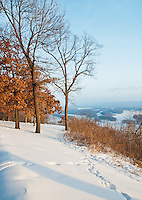 The bluff along the Mississippi River sits covered in snow in winter at Pikes Peak State Park in  Clayton County, Iowa