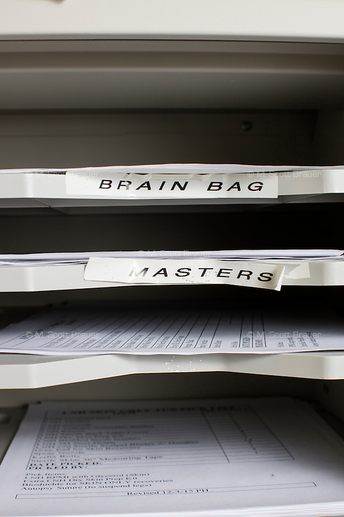 "Labels including ""brain bags"" and ""blue cornea bags"" indicate supplies in a room at the New England Organ Bank, an organ procurement organization based in Waltham, Massachusetts, serving the greater New England area."