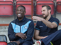 Anthony Stewart of Wycombe Wanderers chats with Paul Hayes of Wycombe Wanderers pre match during the Sky Bet League 2 match between Leyton Orient and Wycombe Wanderers at the Matchroom Stadium, London, England on 19 September 2015. Photo by Andy Rowland.