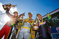 Feb 26, 2017; Chandler, AZ, USA; NHRA top fuel driver Leah Pritchett (left) celebrates alongside funny car driver Matt Hagan (center) and pro stock driver Greg Anderson after winning the Arizona Nationals at Wild Horse Pass Motorsports Park. Mandatory Credit: Mark J. Rebilas-USA TODAY Sports