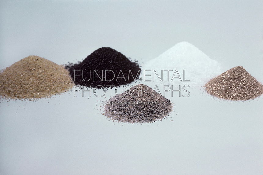 MAGNET ATTRACTS IRON FILINGS MIXED IN SAND (1 of 3)<br /> Left To Right: Sand, Iron Filings, Sugar, and Gold Dust<br /> Before the experiment, several separate compounds are arranged, to be mixed together. Later in the experiment, a bar magnet separates iron filings from a compound mixture of  iron filings, gold dust, sugar, and sand.