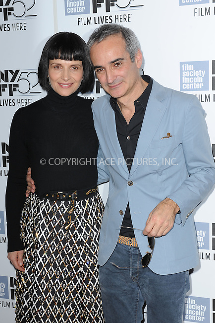 WWW.ACEPIXS.COM<br /> October 8, 2014 New York City<br /> <br />  Juliette Binoche and Olivier Assayas attending a screening of 'Clouds Of Sils Maria'  during the 52nd New York Film Festival at Alice Tully Hall on October 8, 2014 in New York City<br /> <br /> By Line: Kristin Callahan/ACE Pictures<br /> ACE Pictures, Inc.<br /> tel: 646 769 0430<br /> Email: info@acepixs.com<br /> www.acepixs.com