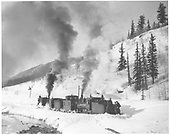 3/4 view of RGS #25 (2nd) and a C-16 engine pushing a caboose and plow-flanger #03 to clear the right-of-way of new snow along the Dolores River at MP 65.4.<br /> RGS  Winkfield, CO