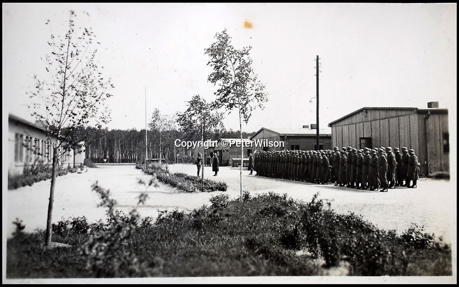 BNPS.co.uk (01202 558833)<br /> Pic: PeterWilson/BNPS<br /> <br /> A parade inside the camp.<br /> <br /> A fascinating photo album has to come to light to reveal what went on inside a German POW camp - including stage shows in drag.<br /> <br /> The Stalag Luft IV B album was compiled by British prisoner David Courtney, of 102 Squadron, whose Halifax was shot down near Berlin on January 20, 1944.<br /> <br /> One of the photos shows the funeral of a British soldier who was assassinated by the German guards, although they have taken part in the ceremony by lifting their guns above the coffin.<br /> <br /> Another shows a theatre performance put on by inmates where the performers were dressed as women to keep up morale.