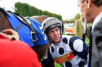 Jockey Jim Crowley unsaddles Mr Top Hat and talks to trainer David Evans after winning The Bathwick Tyres Conditions Stakes during Afternoon Racing at Salisbury Racecourse on 4th October 2017