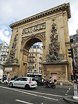 VMI Vincentian Heritage Tour: Members of the Vincentian Mission Institute cohort pass the Porte Saint-Denis Thursday, June 23, 2016, as they toured Vincentian sites in Paris, France. The gate is where the kings of France would pass to enter Paris coming from the Saint-Denis Basilica. These gateways replaced the former medieval toll-gates along the city walls of Paris, and were built in honor of Louis XVI's military victories on the Rhine. (DePaul University/Jamie Moncrief)