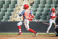 Luis Garcia (7) of the Hagerstown Suns follows through on his swing against the Kannapolis Intimidators at Kannapolis Intimidators Stadium on May 6, 2018 in Kannapolis, North Carolina. The Intimidators defeated the Suns 4-3. (Brian Westerholt/Four Seam Images)