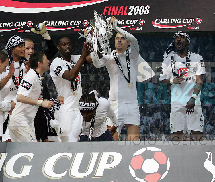 Tottenham's players celebrate with the trophy