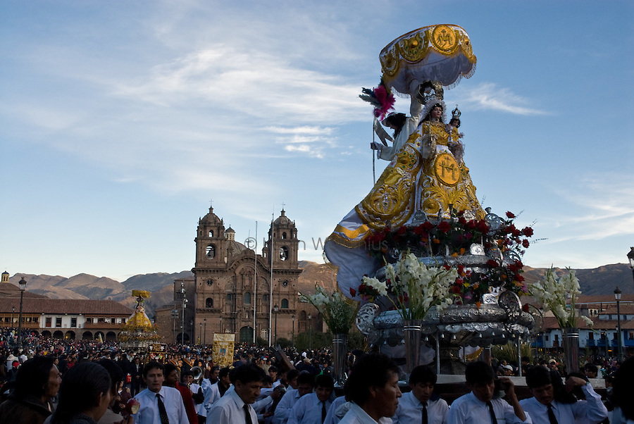 For the annual festival of Corpus Christi, area churches prepare large effigies of their patron saints and bring them to the Cathedral in Cusco. On the night of the festival, the effigies are paraded around Cusco's Plaza de Armas as they begin their journey back to their home churches, some over 20 km away, accompanied by church elders, music, and celebration.