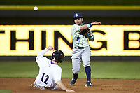 Wilmington Blue Rocks second baseman Ricky Aracena (12) makes a throw to first base as Jordan George (12) of the Winston-Salem Dash slides into second base at BB&T Ballpark on April 15, 2019 in Winston-Salem, North Carolina. The Dash defeated the Blue Rocks 9-8. (Brian Westerholt/Four Seam Images)