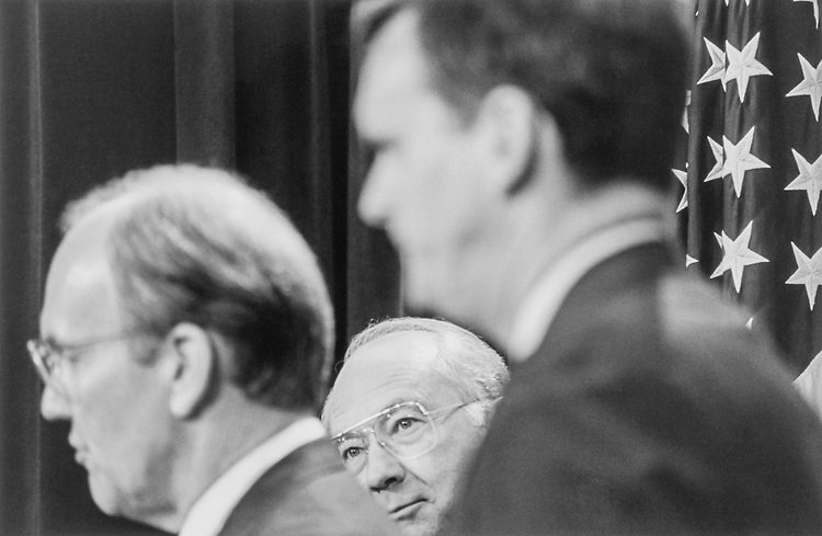 Sen. Phill Gramm, R-Tex., listening to Sen. Larry Craig, R-Idaho, with Sen. Judd Gregg, R-N.H., standing on the right at GOP Press Conference attacking health care bill on Aug. 16, 1994. (Photo by Maureen Keating/CQ Roll Call)