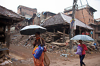 Nepalese women walk through the street in the ancient city of Bhaktapur, in the Kathmandu Valley, Nepal. May 7, 2015