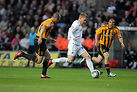 Pictured: Mark Gower of Swansea (C) against James Chester (L) and James Harper (R) both of Hull City. Tuesday 12 April 2011<br />