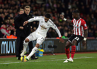 Pictured L-R: Kyle Naughton of Swansea against Eljeo ELia of Southampton Sunday 01 February 2015<br />