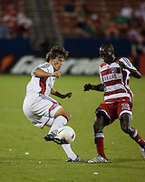 New England Revolution midfielder Wells Thompson (27) attempts to advance past FC Dallas forward Dominic Oduro (25).  New England Revolution defeated FC Dallas 3-2 to capture the 2007 Lamar Hunt U.S. Open Cup at Pizza Hut Park in Frisco, TX on October 3, 2007.