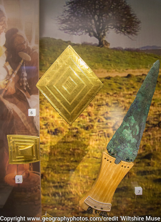 Gold lozenge-shaped sheet and copper dagger from the Bush Barrow chieftain burial site. With permission of Wiltshire Museum, Devizes, England, UK