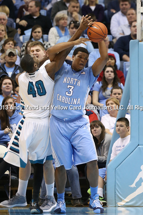 31 December 2013: North Carolina's Kennedy Meeks (3) fights for a rebound with UNC Wilmington's Cedrick Williams (40) and C.J. Gettys (behind). The University of North Carolina Tar Heels played the UNC Wilmington Seahawks at the Dean E. Smith Center in Chapel Hill, North Carolina in a 2013-14 NCAA Division I Men's Basketball game. UNC won the game 84-51.