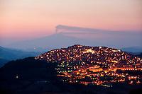 Sunrise over the village of Gangi and a smouldering Mount Etna, Sicily