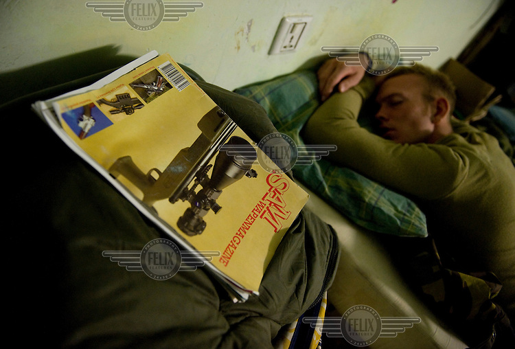 A Dutch soldier of the 11th Infantry Air Assault Battalion from ISAF (the Interntional Security Assistance Force) takes a nap in his quarters at the patrol base in the Chora Valley. ISAF is a peacekeeping mission affiliated to the United Nations (UN) and NATO. ..