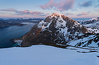 Spring sunset over Stornappstind mountain peak from Slettind, Flakstadøy, Lofoten Islands, Norway
