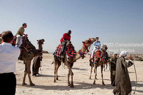 Cairo, Egypt - June 4, 2009 -- Chief of Staff Rahm Emanuel, Personal Aide to the President Reggie Love, and Senior Advisor Valerie Jarrett take a ride on camels in Egypt on Thursday, June 4, 2009. .Mandatory Credit: Pete Souza - White House via CNP