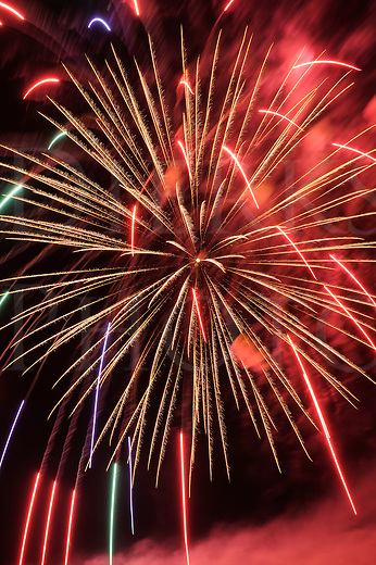 Fireworks red burst explosion against the night sky in holiday celebration, design elements and backgrounds.
