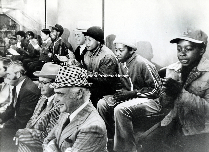 A's owner Charlie Finley in his private box with.Stanley Burrell (later to take the name M.C.Hammer).sitting far upper right  with a bunch of his friends. .(copyright 1974 Ron Riesterer)