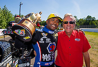 Jun 7, 2015; Englishtown, NJ, USA; NHRA top fuel driver Antron Brown (left) celebrates with team owner Don Schumacher after winning the Summernationals at Old Bridge Township Raceway Park. Mandatory Credit: Mark J. Rebilas-