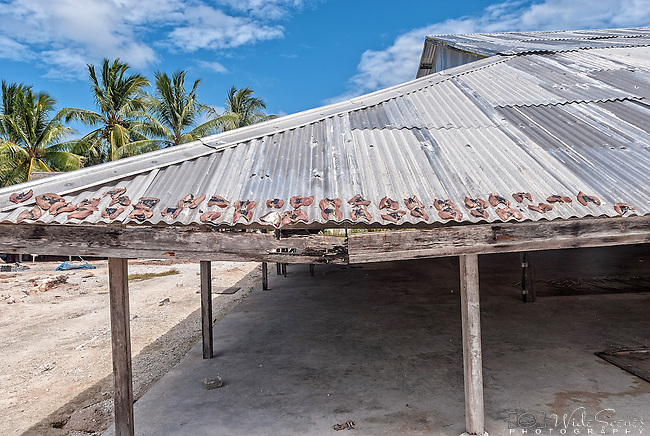 Drying fish on the roof of the village Maneaba. The heart of any Kiribati community is its maneaba or meeting house. The Maneaba is not just the biggest building in any village, it is the centre of village life.