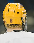 A number of Jake Parenteau's (Minnesota - 6) teammates wear the NA sticker on their helmets in memory of his cousin Nicole Anderson who died in January. - The University of Minnesota Golden Gophers practiced on Wednesday, April 4, 2012, during the 2012 Frozen Four at the Tampa Bay Times Forum in Tampa, Florida.