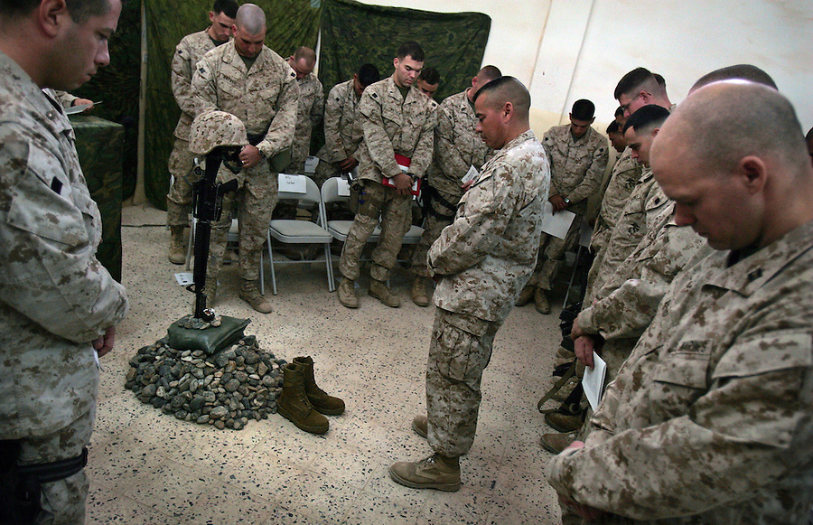 A memorial service for Lance Corporal Miguel Terrazas killed in action by an IED in Haditha, Iraq on Nov. 19, 2005. The service was held at the company's firm base on Tues. Nov. 29, 2005.