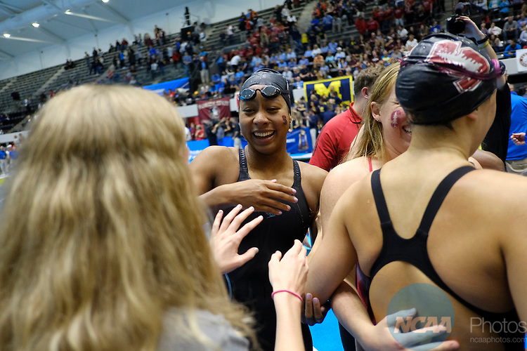 INDIANAPOLIS, IN - MARCH 18: Lia Neal  of Stanford celebrates withe her team after helping set  a new NCAA record in the 400-meter freestyle relay during the Division I Women's Swimming & Diving Championships held at the Indiana University Natatorium on March 18, 2017 in Indianapolis, Indiana. (Photo by A.J. Mast/NCAA Photos via Getty Images)
