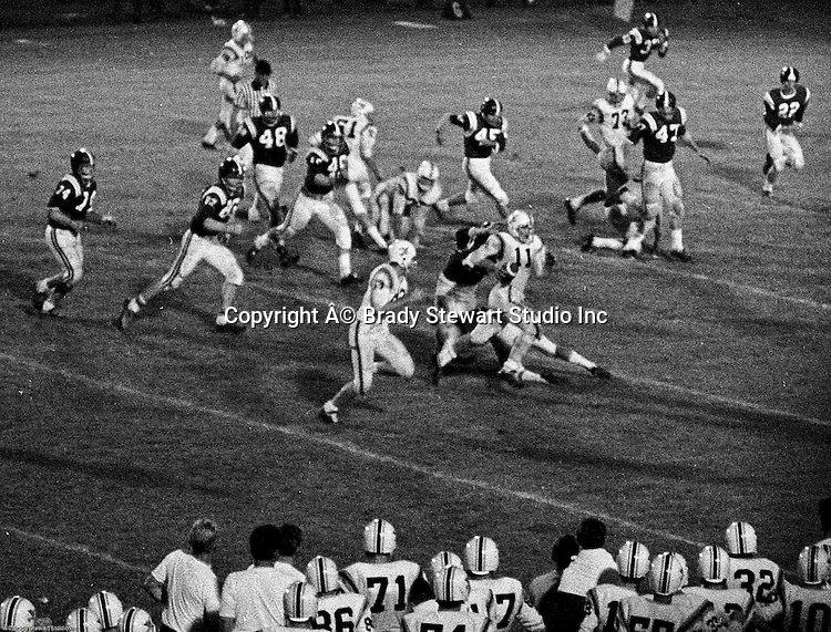 Bethel Park PA:  Offensive play with Mike Stewart 11 and Mike Fassinger 83 running the option - 1970.  Great crackback block by Bruce Evanovich 80.  Others in the photo; Don Troup 51, Jim Dingeldine 73.  After Scott Streiner was injuried on the first play, the team rallied and came up just short of winning the game when they missed a two-point conversion late in the 4th quarter (7-6).  Defensive unit was one of the best in Bethel Park history only allowing a little over 7 points a game.