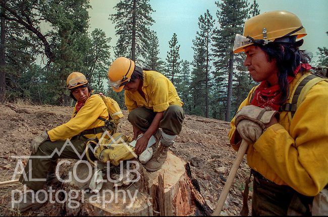 August 10, 1990 Yosemite National Park  --  A-Rock (Arch Rock) Fire  -- Fire crews from Fort Apache, Arizona check equipment before hiking to work the fireline. The Arch Rock Fire burned over 16,000 acres of Yosemite National Park and the Stanislaus National Forest.  At the same time across the Merced River, the Steamboat Fire burned over 5,000 acres of both Yosemite National Park and the Sierra National Forest.
