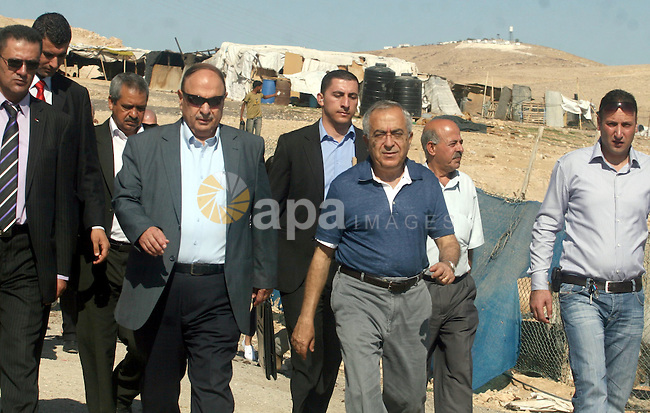 "Palestinian Prime Minister Salam Fayyad visits the school ""al-Khan al-Ahmar"", on the first day of the new school year, in Abu Hindi valley in the bedouin, in occupied West Bank near Jericho, on September 2, 2012. Photo by Issam Rimawi"