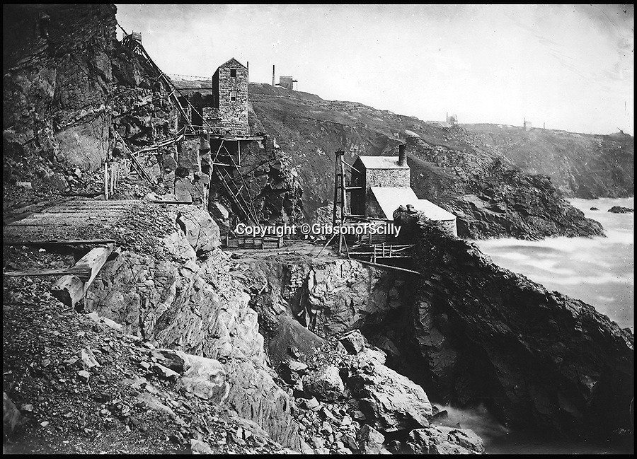 BNPS.co.uk (01202 558833)<br /> Pic: GibsonOfScilly/BNPS<br /> <br /> Crown engine at Botallick mine in the 1890's - actually used in the Poldark series.<br /> <br /> An archive of eye-opening photographs documenting the grim reality of Poldark's Cornwall has emerged for sale for &pound;25,000.<br /> <br /> More than 1,500 black and white images show the gritty lives lived by poverty-stricken families in late 19th and early 20th century Cornwall - around the same time that Winston Graham's famous Poldark novels were set.<br /> <br /> The collection reveals the lowly beginnings of towns like Rock, Fowey, Newquay and St Ives long before they became picture-postcard tourist hotspots.<br /> <br /> Images show young filth-covered children playing barefoot in squalid streets, impoverished families standing around outside the local tax office, and weather-beaten fishwives tending to the day's catch.<br /> <br /> The Cornish archive, comprising 1,200 original photographic prints and 300 glass negative plates, is tipped to fetch &pound;25,000 when it goes under the hammer as one lot at Penzance Auction House.