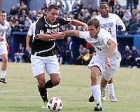 Tommy Muller #8 of Georgetown University pushes away from Wilder Arboleda #20 of Providence University during a Big East quarter-final  match at North Kehoe Field, Georgetown University on November 6 2010 in Washington D.C. Providence won 2-1.