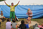 Roger the Jester (Roger Reed) performing to the delight of children and adults outside the Family Tent at the 24th Annual Falcon Ridge Folk Festival,held at Dodds Farm, Hillsdale NY on Sunday July 29, 2012. Photograph taken by Jim Peppler. Copyright Jim Peppler/2012