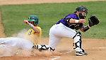 SIOUX FALLS, SD - MAY 24:  Wes Satzinger #31 from NDSU slides safely into home as Adam McGinnis #12 from Western Illinois waits for the ball in the first inning of the 2014 Summit League Baseball Championship game Saturday afternoon at the Sioux Falls Stadium. (Photo by Dave Eggen/Inertia)