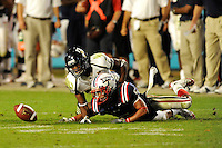 29 November 2008:  FIU defensive back O'Darris D'Haiti (20) forces Florida Atlantic defensive back Tavious Polo (5) to fumble a kick-off in the FAU 57-50 overtime victory over FIU in the annual Shula Bowl at Dolphin Stadium in Miami, Florida.
