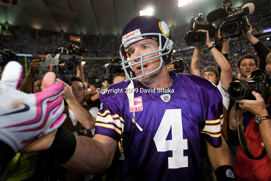 Minnesota Vikings quarterback Brett Favre (4) is surrounded by media after an NFL football game against the Green Bay Packers at the Hubert H. Humphrey Metrodome on October 5, 2009 in Minneapolis, Minnesota. The Vikings won 30-23. (AP Photo/David Stluka)