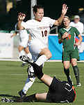 7 November 2007: Virginia's Kelly Quinn (10) leaps over Miami goalkeeper Lauren McAdam (on ground). The University of Virginia tied the University of Miami 0-0 at the Disney Wide World of Sports complex in Orlando, FL in an Atlantic Coast Conference tournament quarterfinal match.  Virginia advanced to the semifinals on penalty kicks, 4-2.