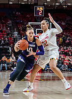 COLLEGE PARK, MD - JANUARY 26: Lindsey Pulliam #10 of Northwestern barrels past Blair Watson #22 of Maryland during a game between Northwestern and Maryland at Xfinity Center on January 26, 2020 in College Park, Maryland.