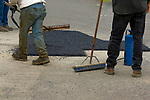 Asphalt patch with boots and tools